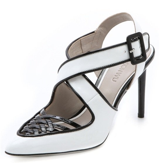 These two-tone, patent spectator pumps are detailed with ladylike latticework on the vamp and a mod crisscross buckle strap under the ankle