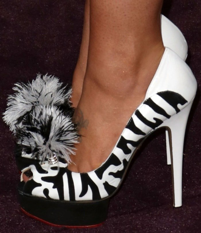 Kelly Osbourne's shoes feature black suede detail and ostrich feather embellishment