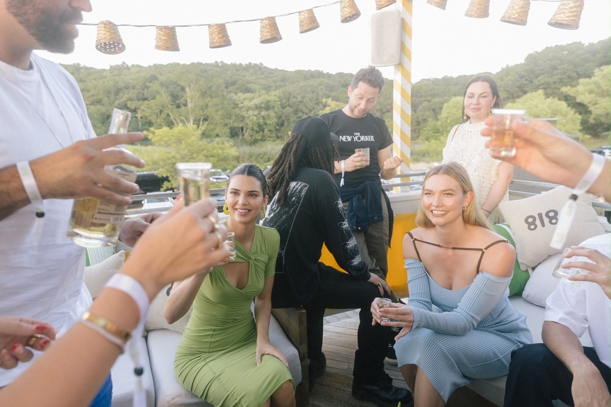 Kendall celebrated her 818 Tequila in a green Sanda Simona Studio draped mid-length dress at a rooftop party in New York