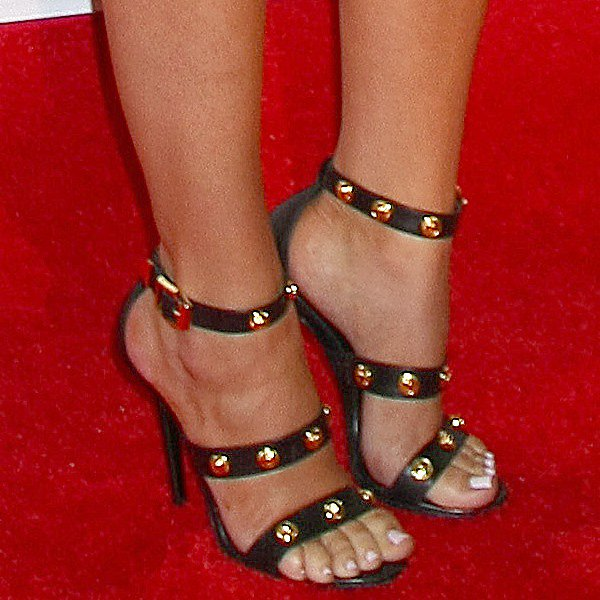Khloe Kardashian's Versace shoes with gold Medusa studs on the straps