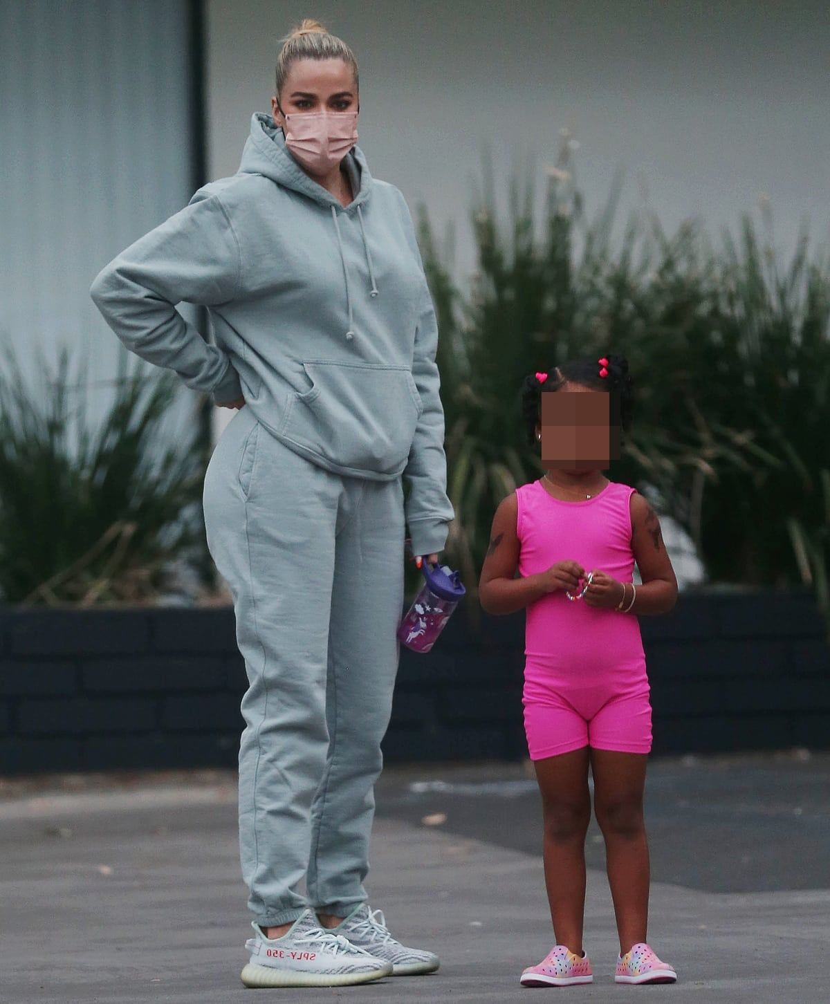 Khloe Kardashian supports Kanye West's footwear collaboration in grey sweatpants with her daughter True Thompson