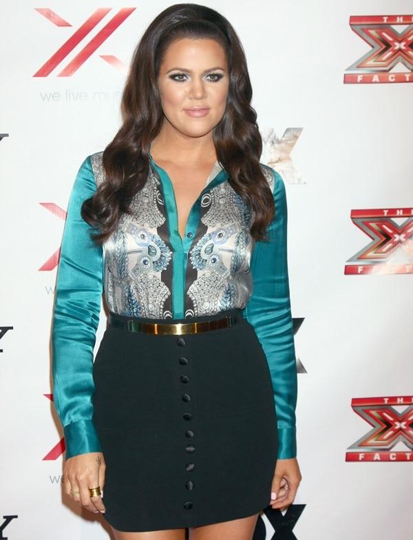 Khloé Alexandra Kardashian styled a Temperley London foulard print blouse with a Dolce & Gabbana Lily of the Valley skirt