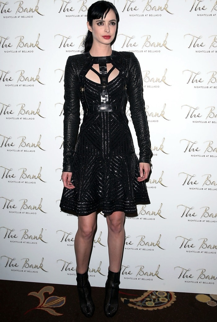 Krysten Ritter donned a black futuristic number from Hervé Léger by Max Azria and capped off her look with an interesting set of mesh ankle booties from Rachel Zoe