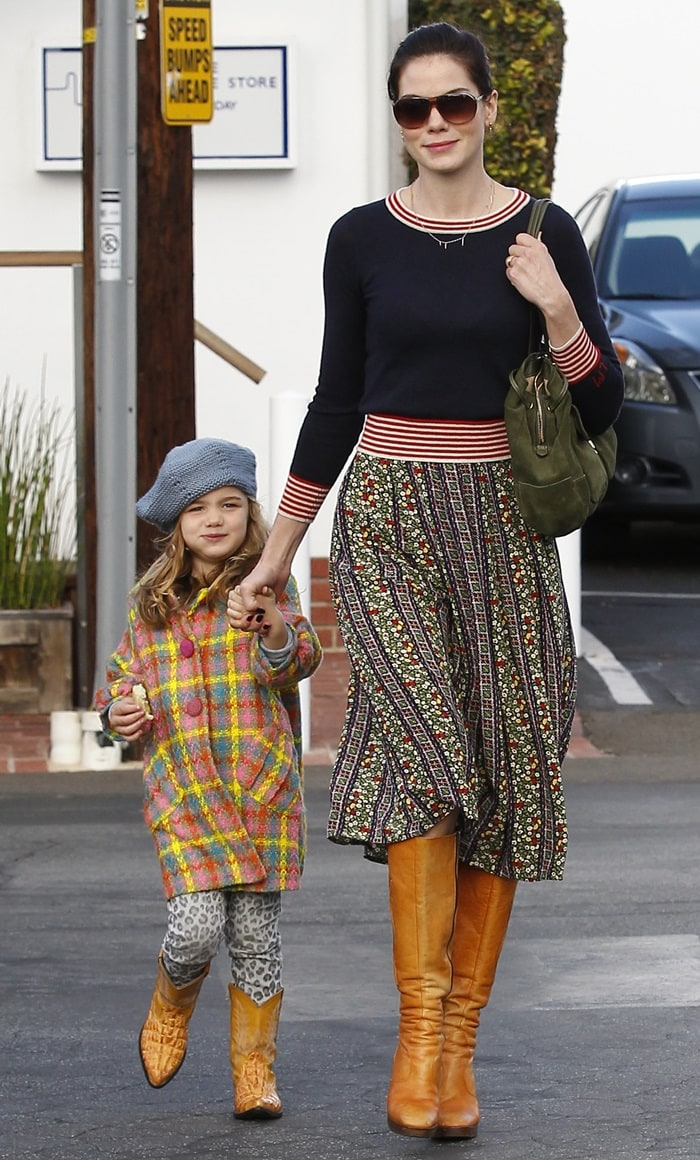 Little Willow wore a multicolored tweed coat, leopard print leggings, a grey beret and cowboy boots of the same color as her mom's
