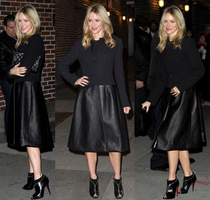Naomi Watts wears a black leather Calvin Klein coat over a Stella McCartney dress