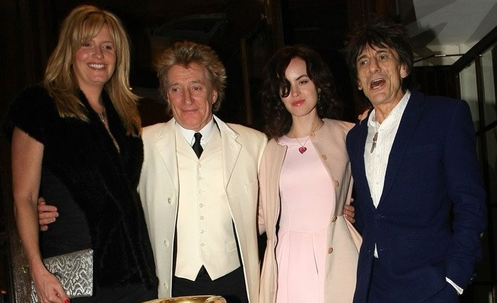 Ronnie Wood and Sally Humphreys pose with Penny Lancaster and Rod Stewart at The Dorchester hotel