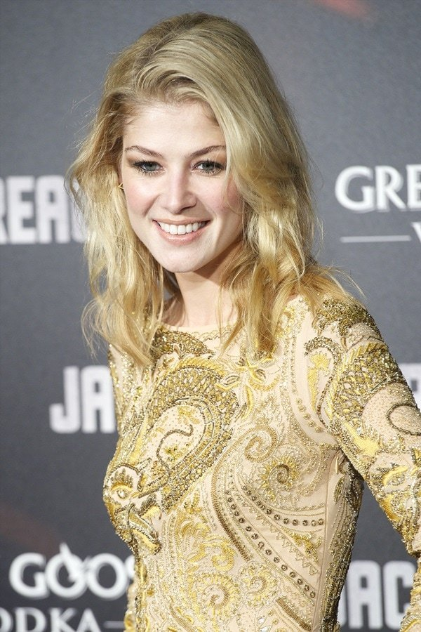 Rosamund Pike's gold embroidered long sleeve cocktail dress