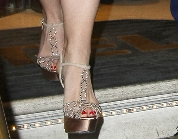 Sally Humphreys opts to wear a sparkling pair of Sergio Rossi heels for her wedding reception