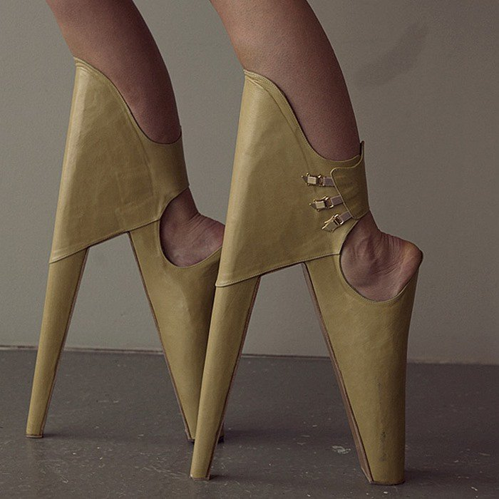 Artist Leanie van der Vyver conceptualized these shoes to be worn with the heels in front and the platform at the back