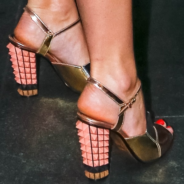 Alice Eve wearing pyramid-stud-detailed metallic sandals