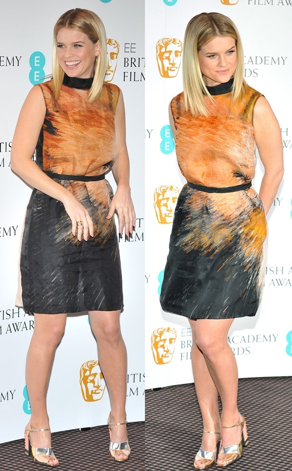 Alice Eve in a stunning orange-and-black printed dress from the Fendi Spring 2013 collection