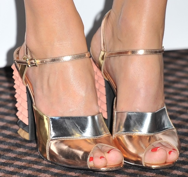Alice Eve wearing pyramid stud metallic sandals
