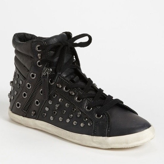 A chunky collar and grungy sole complete the cool of a high-top sneaker peppered with diminutive skulls