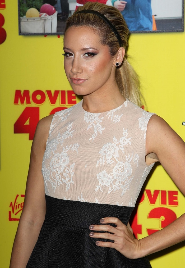 Ashley Tisdale wearing a dress from Philip Armstrong