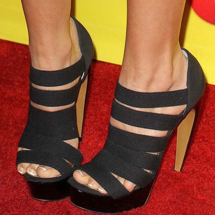 Actress Ashley Tisdale wearing strappy cutout-detailed Walter Steiger heels