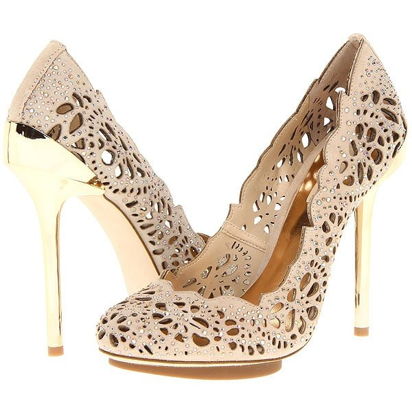 A mirrored-metal heel elevates a lacy, cutwork pump traced with sparkly crystals