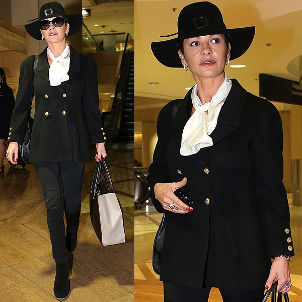 Catherine Zeta Jones is in a world of her own in this witch hat-topped ensemble