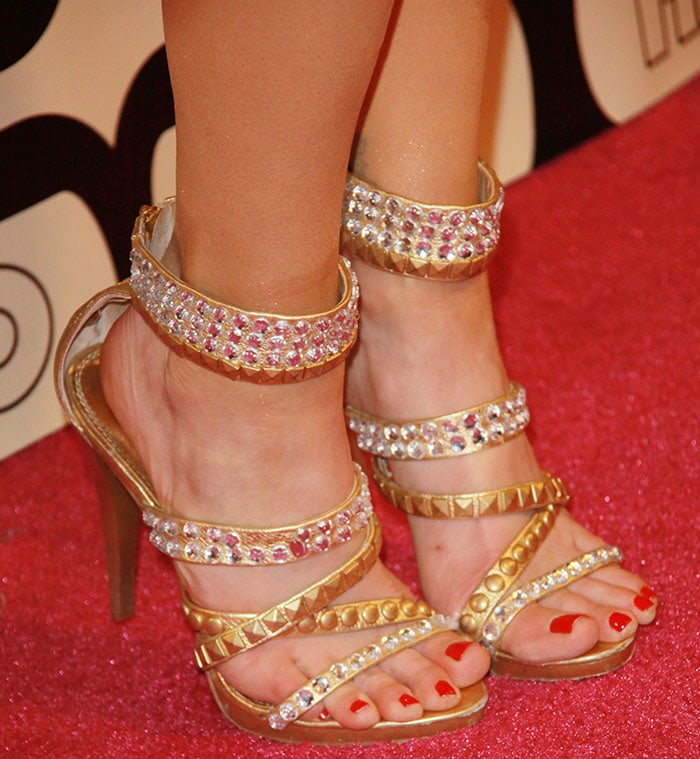 Christa Campbell's size 8 (US) feet in gold strappy sandals