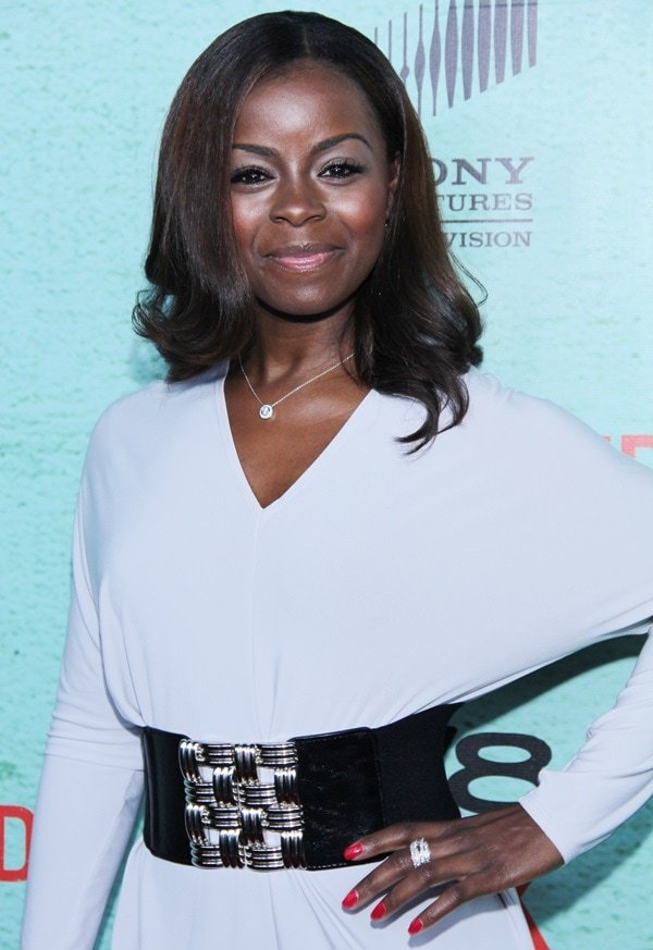 Erica Tazel added a thick black belt over her all-white dress