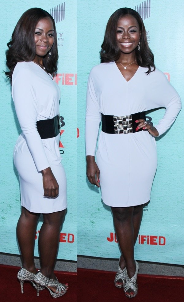 Erica Tazel in a chic white Calvin Klein dress and sexy python sandals