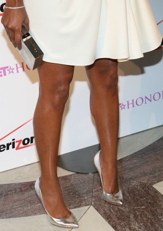 Leggy Gabrielle Union shows off her feet inmirrored silver patent leather pointy-toe pumps