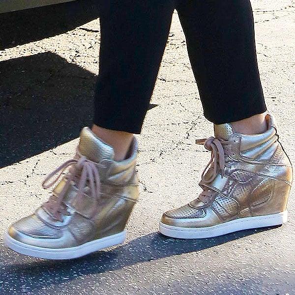 Jenna Dewan in gold wedge sneakers