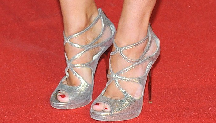 Kimberley Garner showing off her pedicure in silver Jimmy Choo sandals