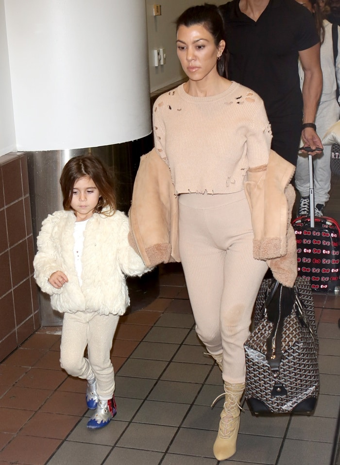 Kourtney Kardashian in a distressed White Fox 'Bronx' knit crop styled with matching 'Lenox' leggings