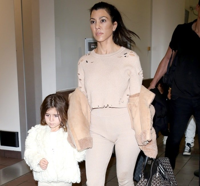 Kourtney Kardashian and Penelope Scotland Disick at Los Angeles International Airport arrivals in Los Angeles, California, on February 4, 2018