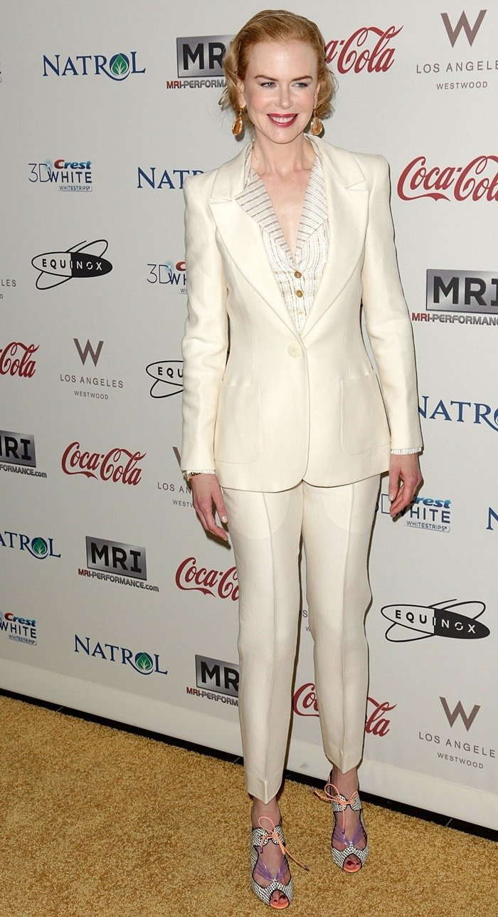 Nicole Kidman styled her shoes with a white Oscar de la Renta suit and Cathy Waterman earrings.
