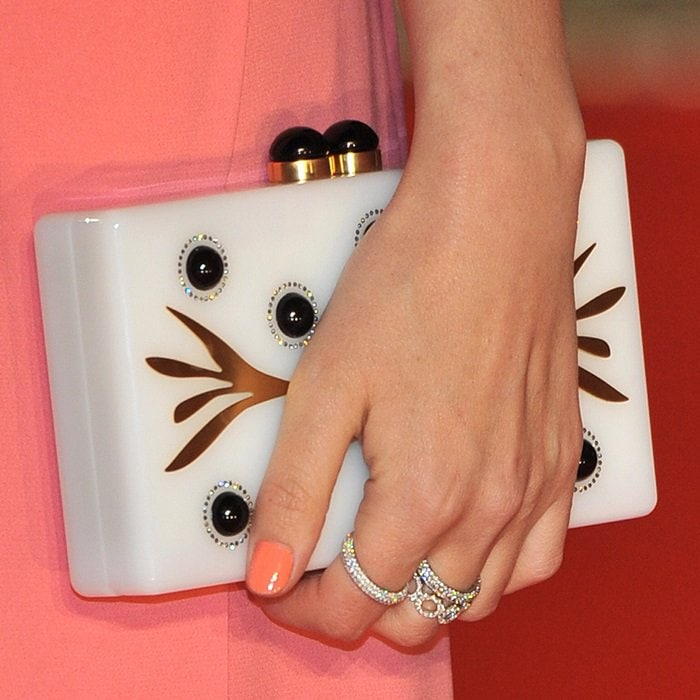 Rose Byrne toting an ivory clutch by Thale Blanc