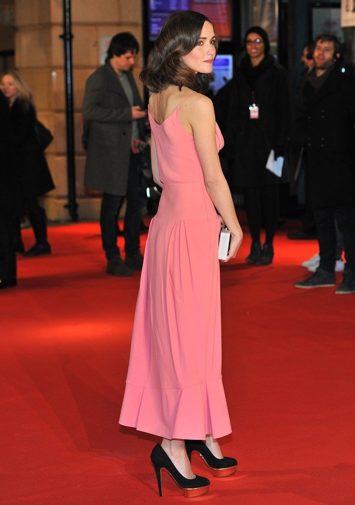 Rose Byrne wearing a soft and flowing peach-coral-toned dress by Balenciaga at the European Premiere of 'I Give It A Year' at Vue West End on January 24, 2013 in London, England