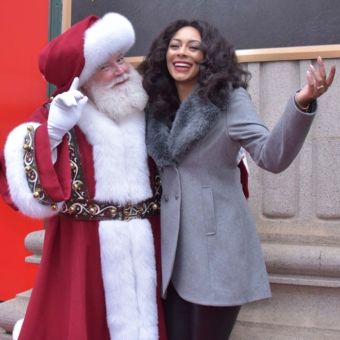 Santa Claus and singer-songwriter Keri Hilson attend Macy's Center City Holiday Window Unveiling