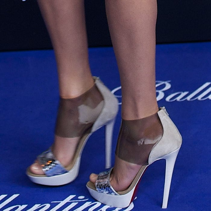 Taylor Swift in snake-print and transparent PVC platform Dufoura sandals from Christian Louboutin's Spring 2013 collection