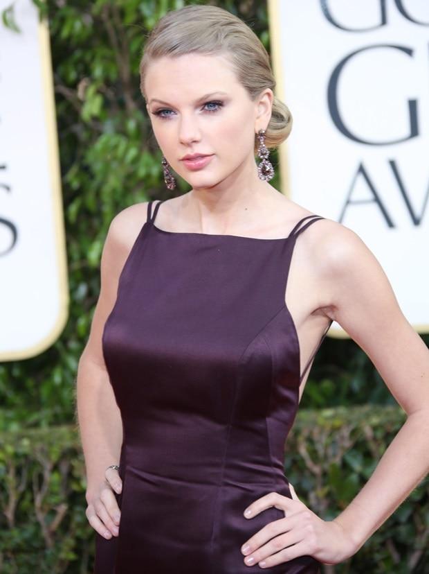 Taylor Swift wore a dark plum taffeta dress and blackened platinum, diamond, and ruby earrings from Lorraine Schwartz