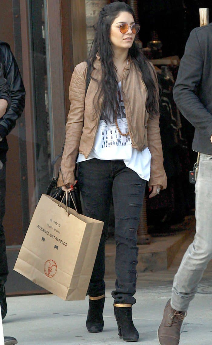 Vanessa Hudgens had on a buttery brown leather jacket paired over a loose white top and ripped skinny jeans