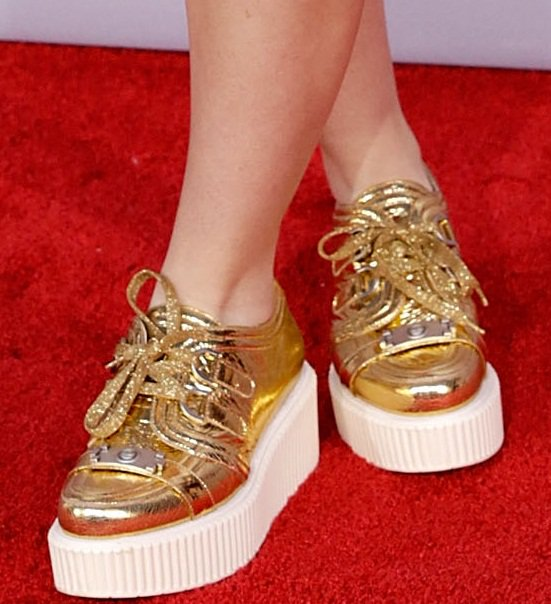 Kathryn's gold flatform Chanel sneakers