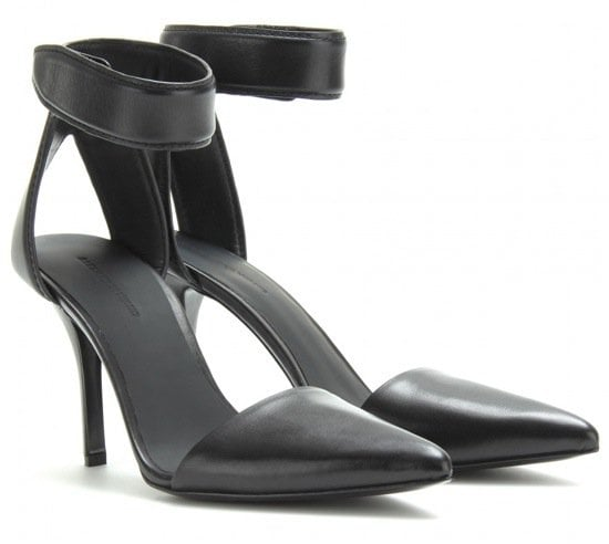 An elegant tapered toe and Velcro® ankle strap lend a sleek, minimalist look to these smooth leather Alexander Wang pumps