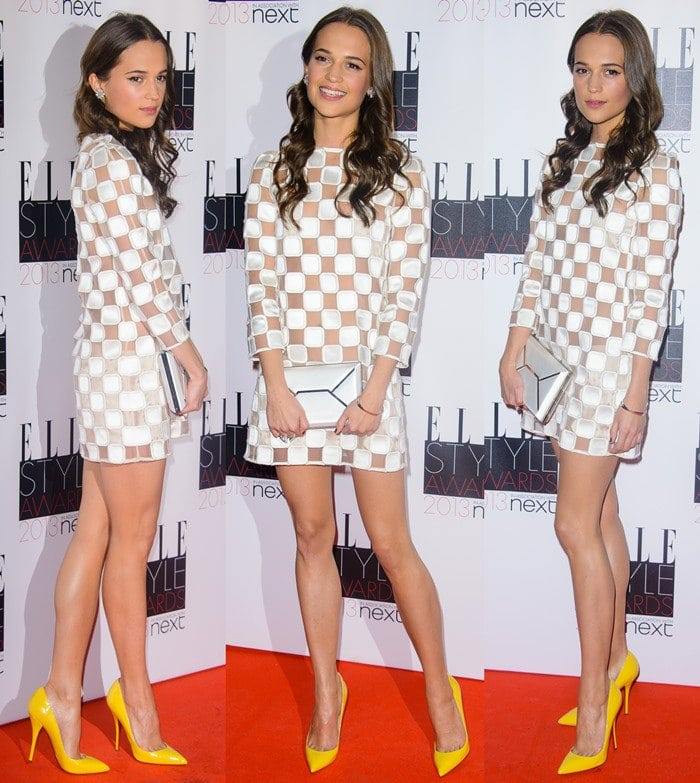 Alicia Vikander flaunted her sexy legs in a checquerboard-inspired dress from Louis Vuitton