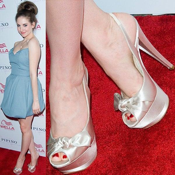 Alison Brie wearing peep-toe heels