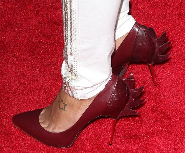 Angela Simmons shows off her star foot tattoo in Monika Chiang pumps