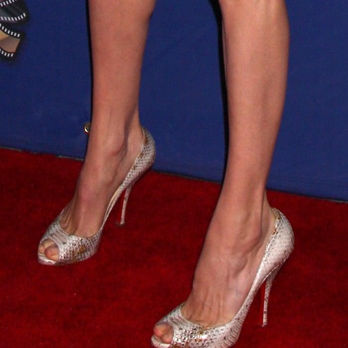 Angelina Jolie's feet in snakeskin Louboutins