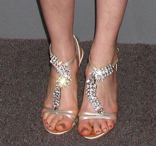 Anne Hathaway's sexy feet in Giuseppe Zanotti embellished heels