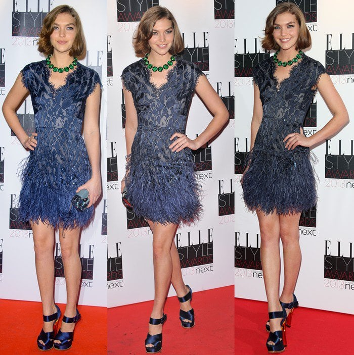 Arizona Muse with a sweet bob hairstyle in a blue fringe dress