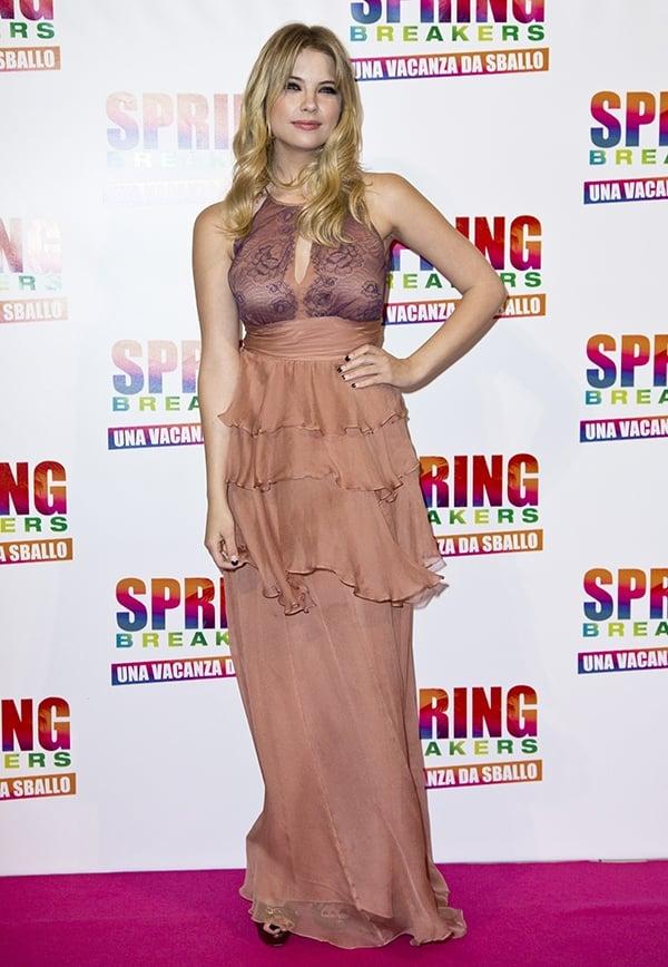 Ashley Benson wears a ruffled chiffon Alberto Franci dress on the pink carpet