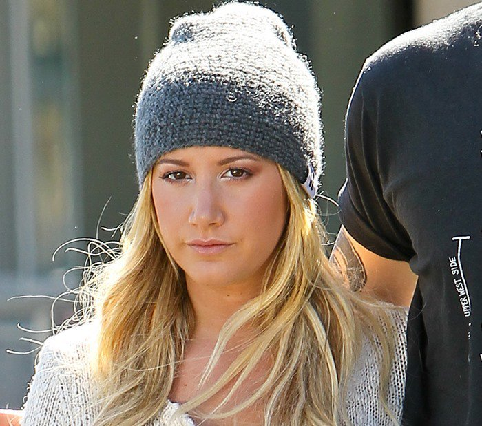 Ashley Tisdale rocks a sweater and a beanie