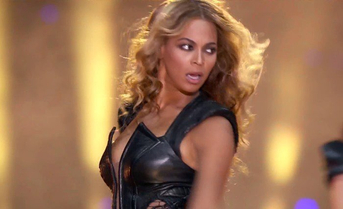 Beyonce performs at the Super Bowl wearing a black leather bodysuit from Rubin Singer
