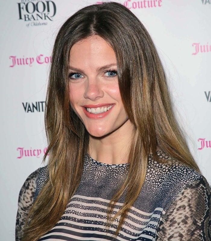 Brooklyn Decker wears her hair down at the Vanity Fair And Juicy Couture Celebration Of The 2013 Vanities Calendar