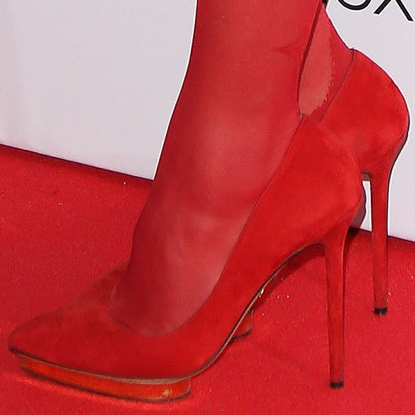 Charlotte Olympia Dellal wears red stockings with matching heels
