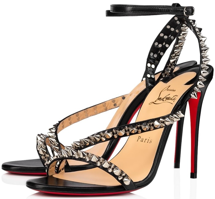 Mafaldina is decorated with silver-tone spikes, a signature detail Christian Louboutin